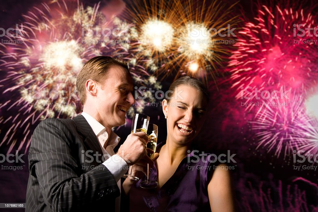 Young couple on New Year's Eve with fireworks royalty-free stock photo