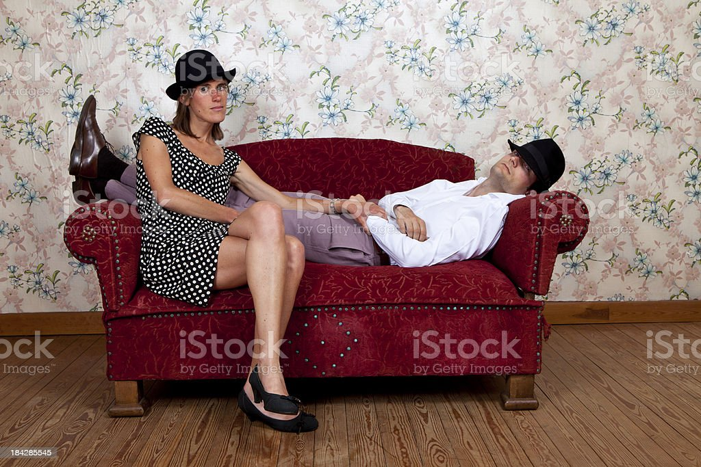 Young couple on old school couch royalty-free stock photo