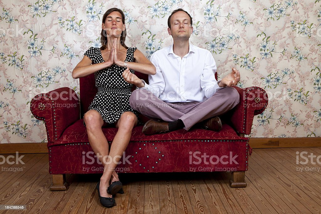 Young couple on old school couch stock photo