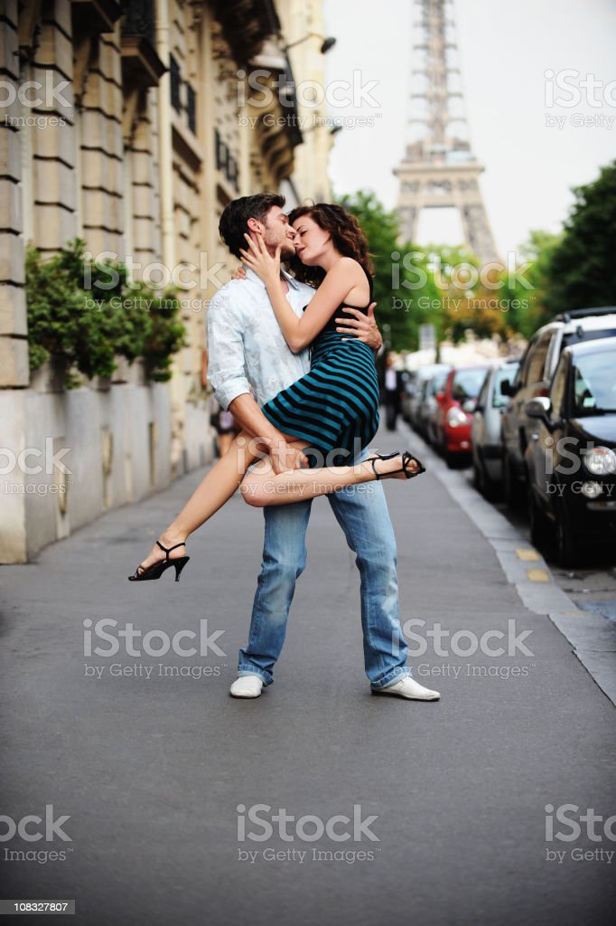 Young couple on Paris Street with the Eiffel Tower stock photo