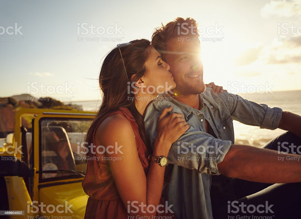 Young couple on romantic road trip stock photo