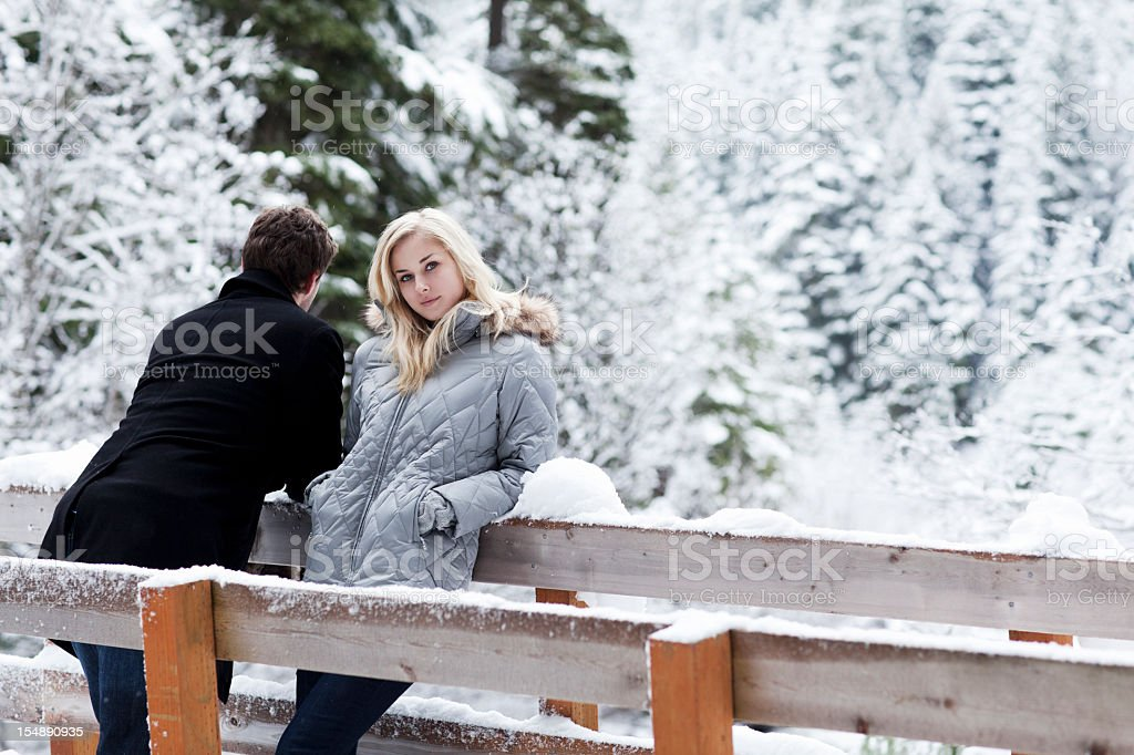 Beautiful Young Woman Posing in Winter Coat on Bridge, Copyspace stock photo