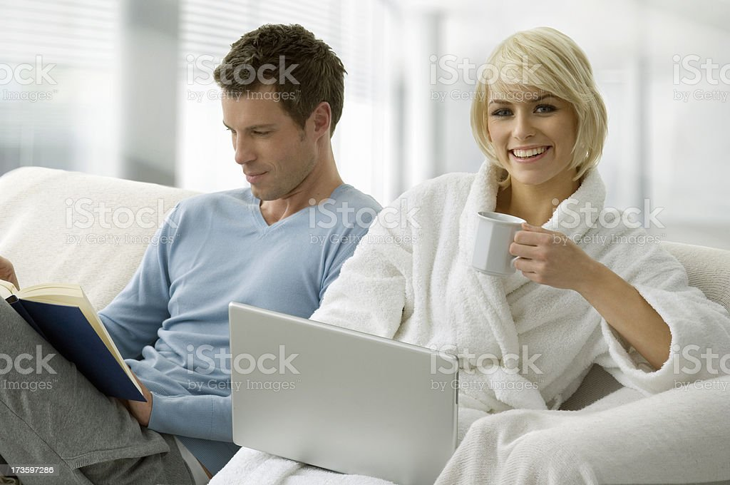 Young Couple on Sofa royalty-free stock photo