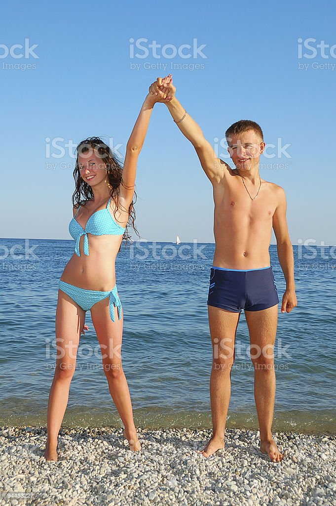 young couple on summer beach stock photo