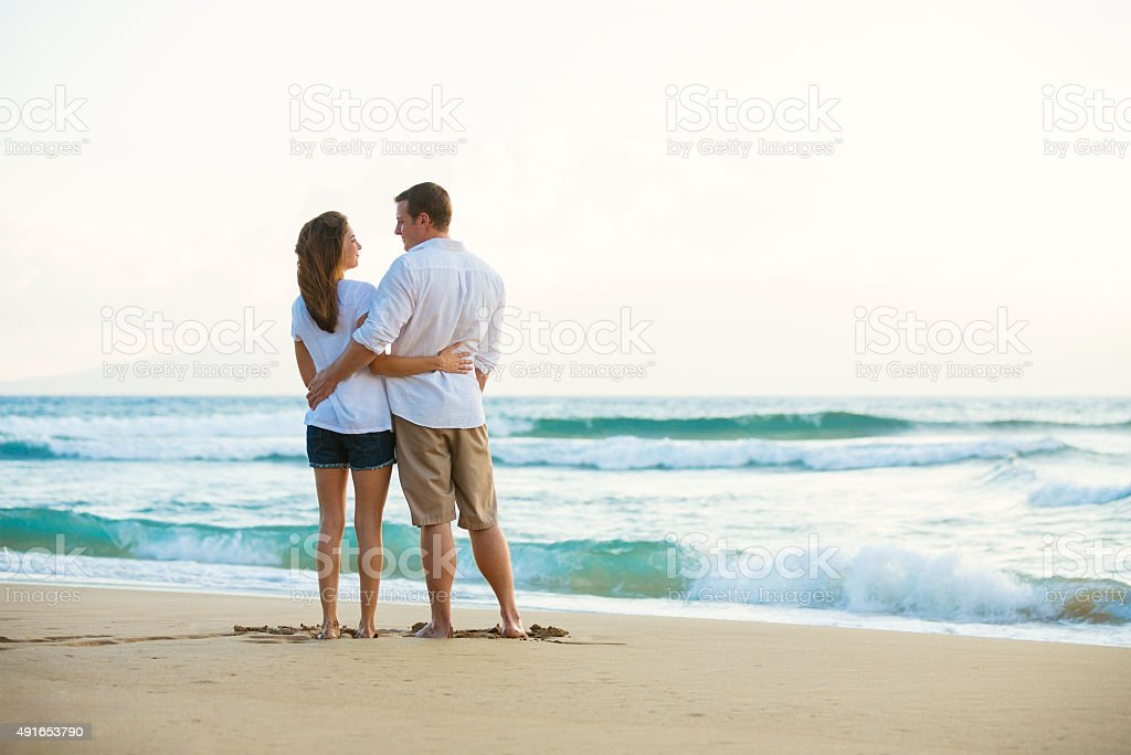 Young Couple on the Beach at Sunset stock photo