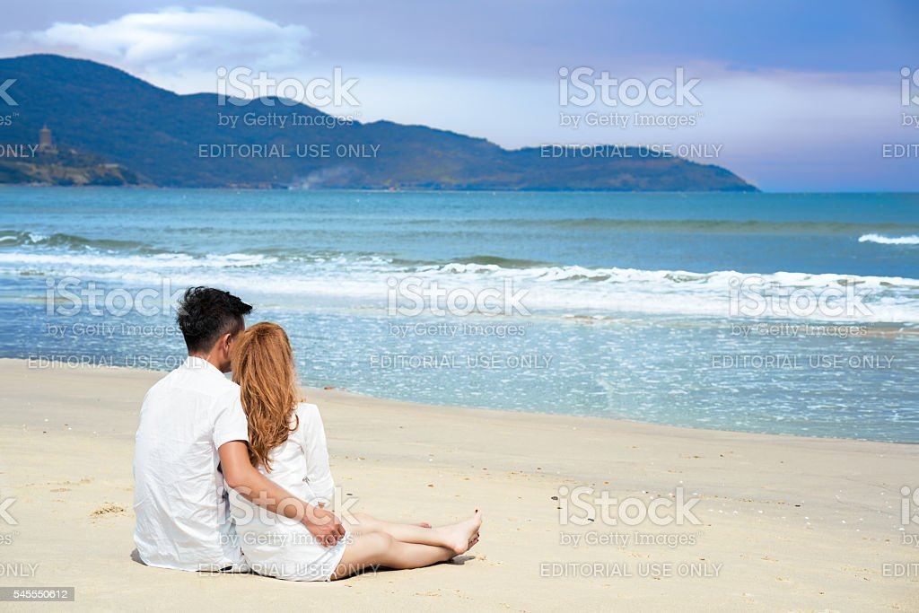 Young couple on the Beach in Da Nang in Vietnam stock photo
