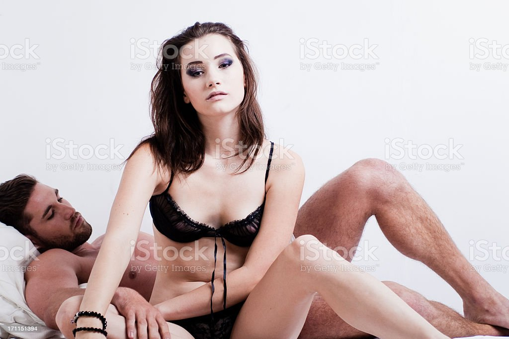A young couple on the bed early in the morning passionately  stock photo