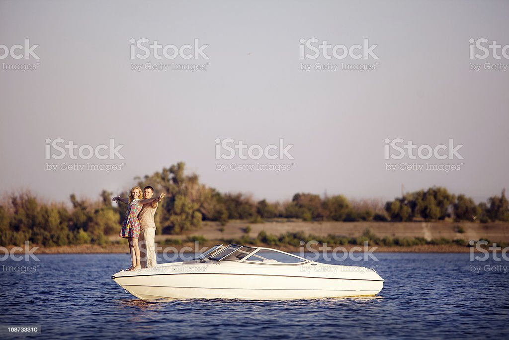 young couple on the boat royalty-free stock photo