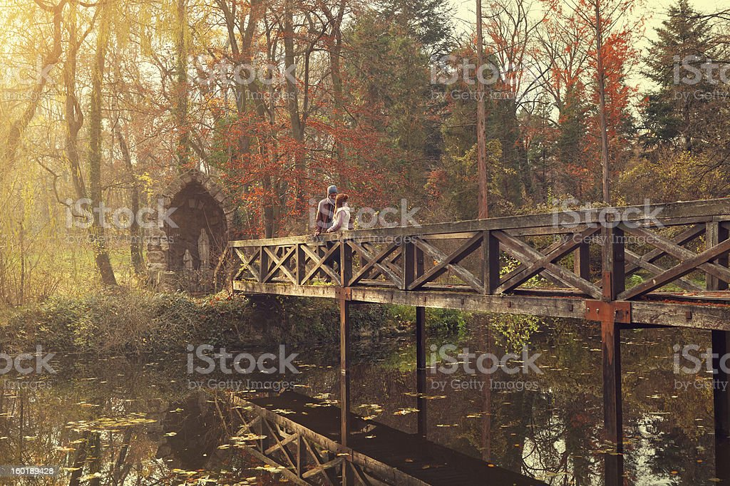 young couple on the bridge royalty-free stock photo