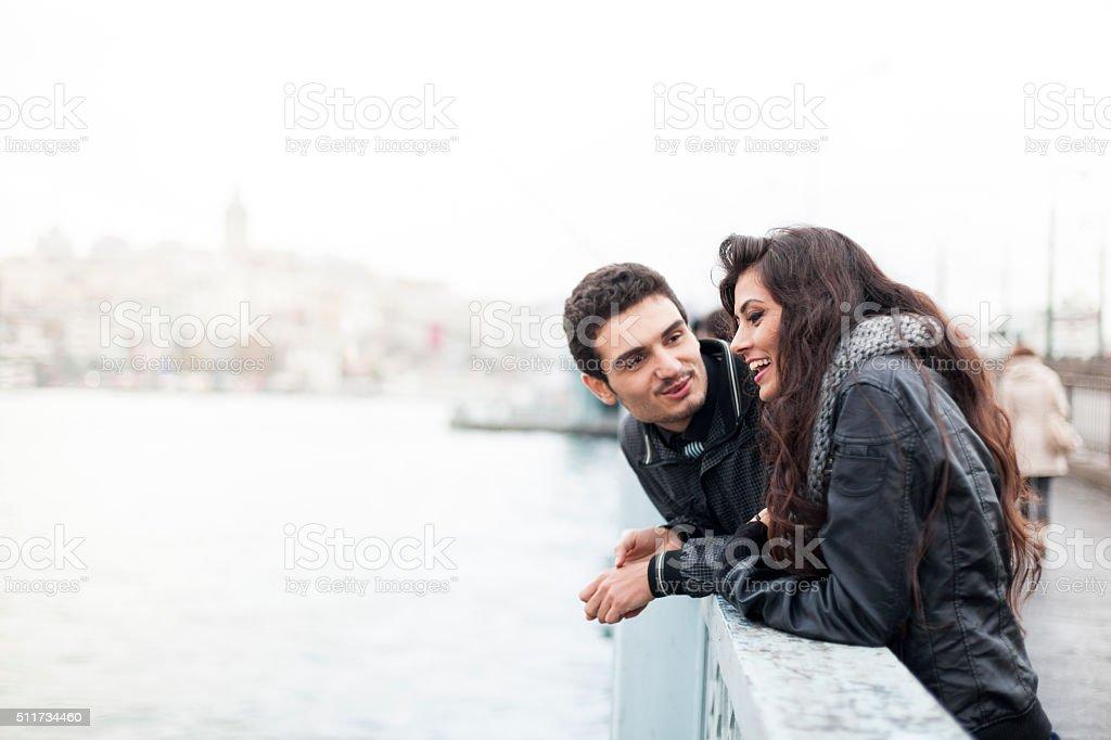 Young Couple On The Galata Bridge In Istanbul stock photo