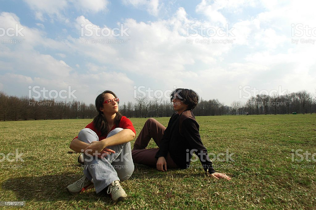 young couple on the grass royalty-free stock photo