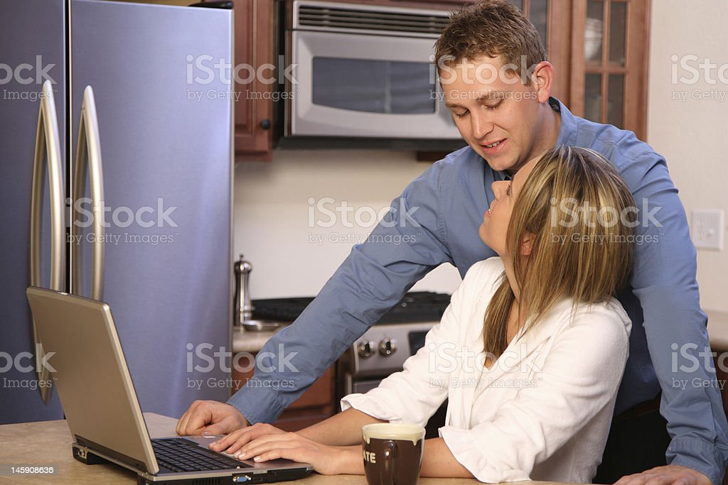 Young couple on the kitchen royalty-free stock photo