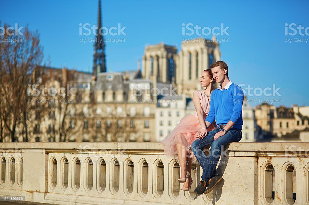 Young couple on the Seine embankment in Paris stock photo