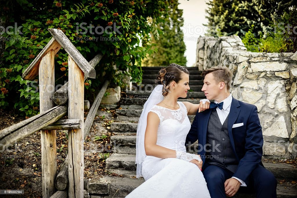 Young couple on the stairs in the park. stock photo