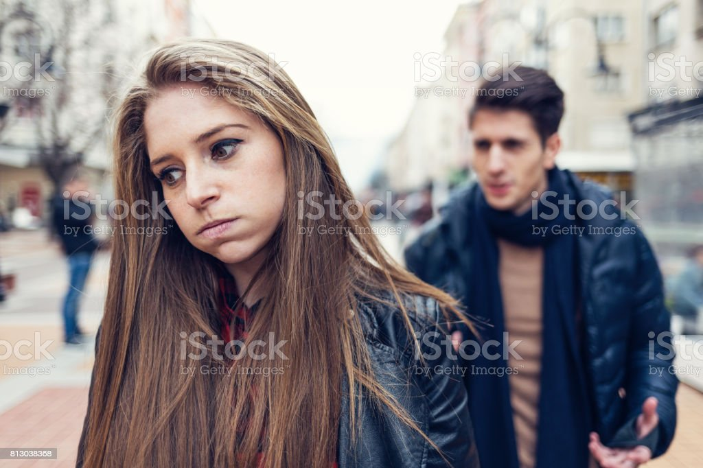 Young couple on the street arguing stock photo