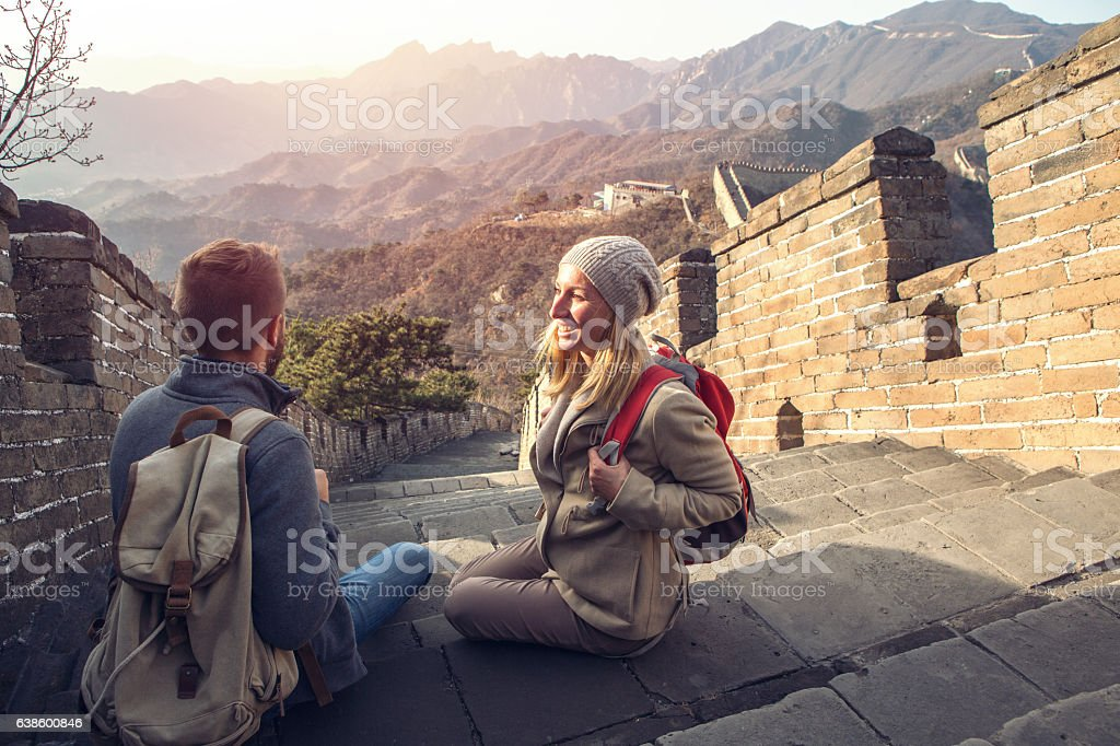 Young couple on top of the Great Wall of China stock photo