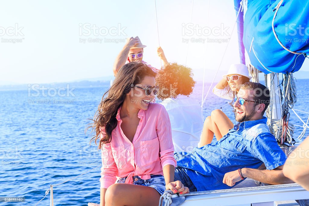 Young couple on vacation with friends stock photo