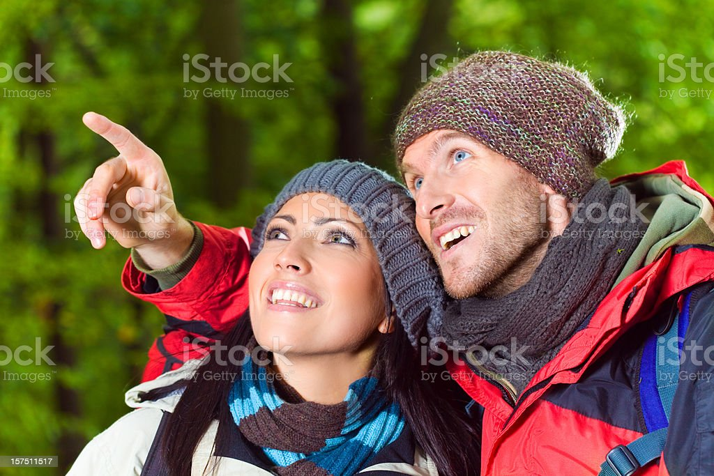 Young Couple Outdoors Looking Up royalty-free stock photo