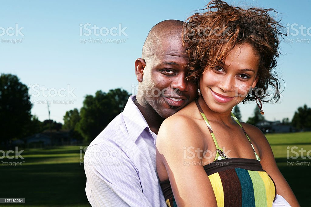 Young Couple Outside in a Summery Field royalty-free stock photo