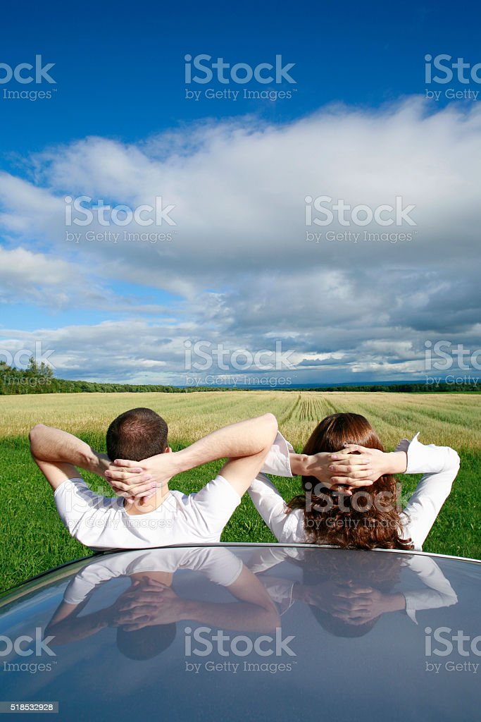 Young couple overlooking farmland. stock photo