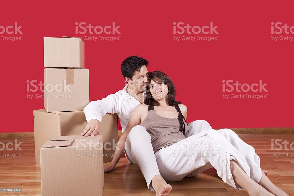 young couple packing royalty-free stock photo