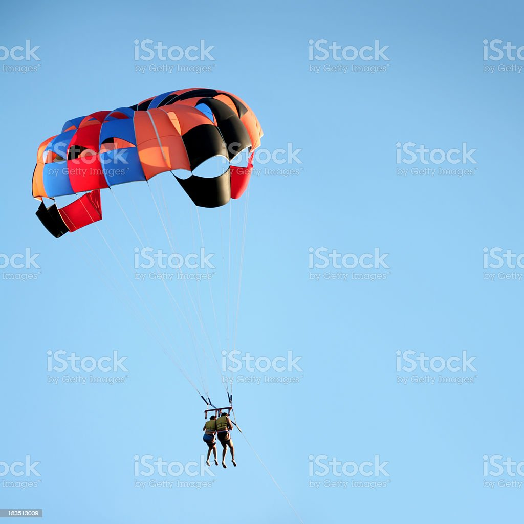young couple parachuting royalty-free stock photo