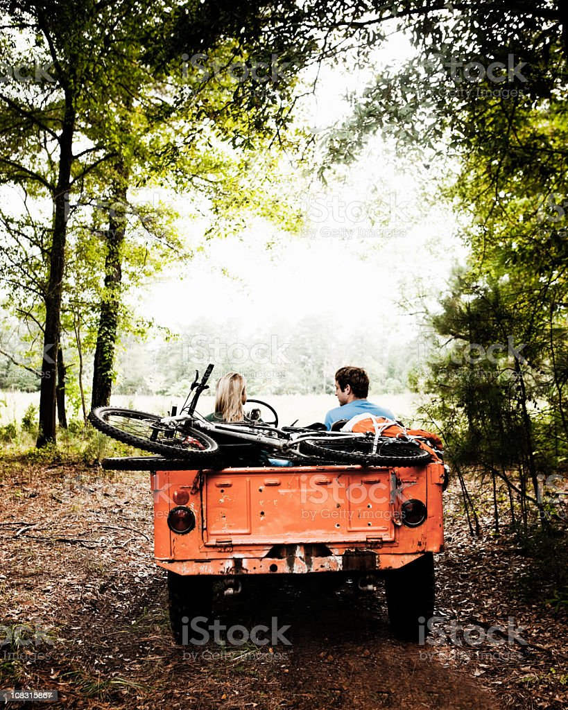 Young Couple Parked in Woods royalty-free stock photo
