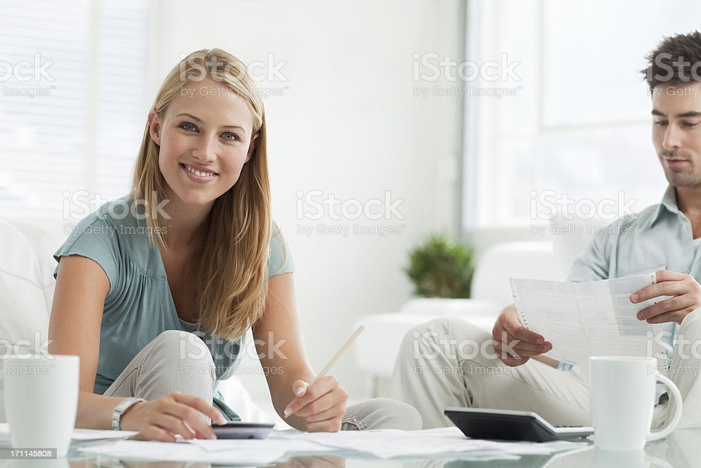 Young Couple paying bills. stock photo