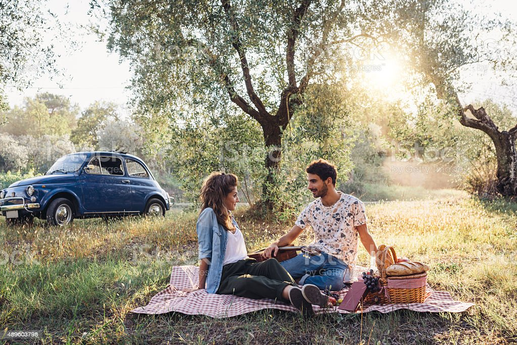 Young Couple Picnic At Sunset stock photo