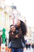 Young couple piggyback in the city