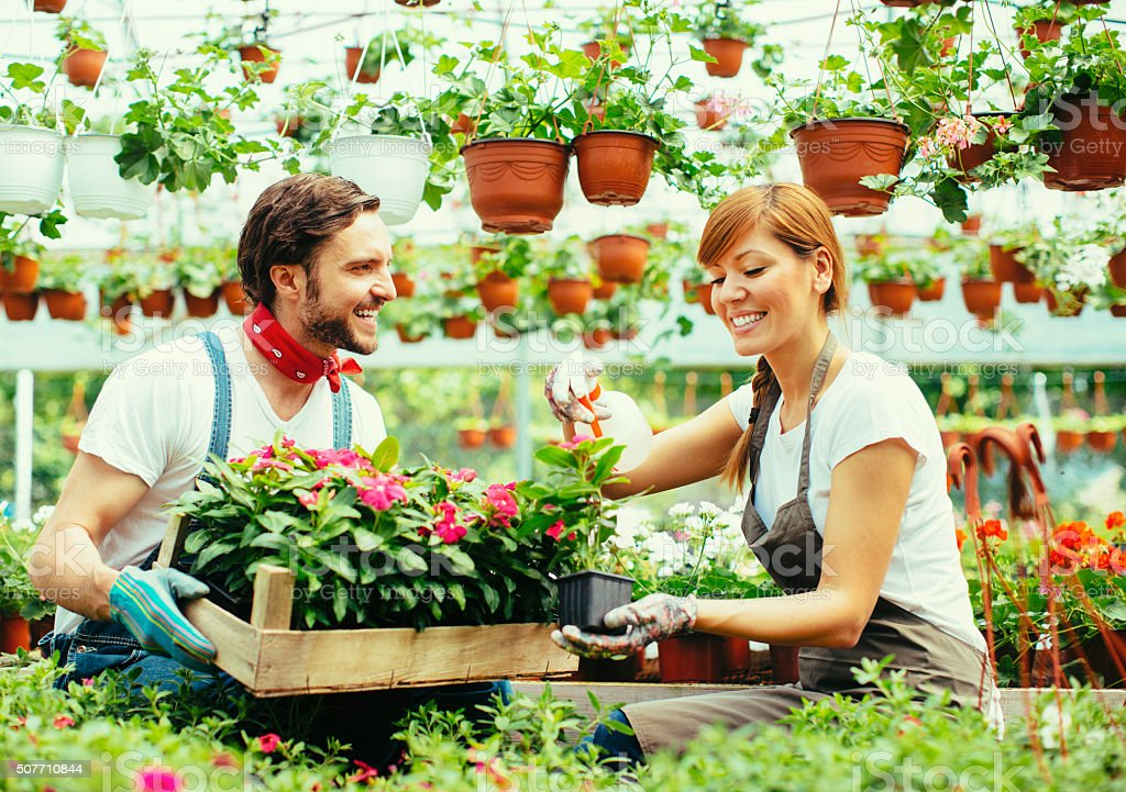 Young Couple Plant Nursery Startup Business stock photo
