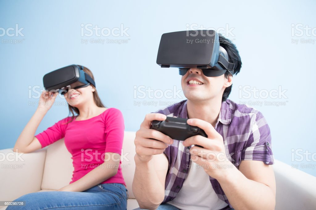 young couple play vr game stock photo
