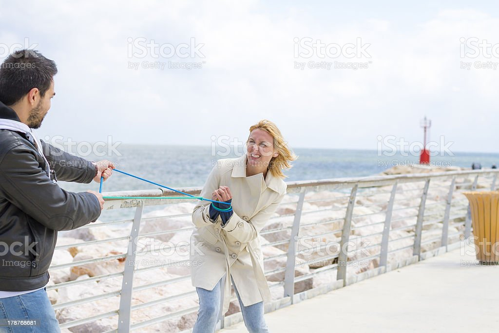 Young couple play with rope royalty-free stock photo