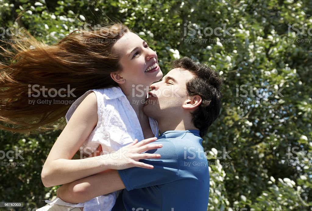 Young couple playing around in the nature stock photo