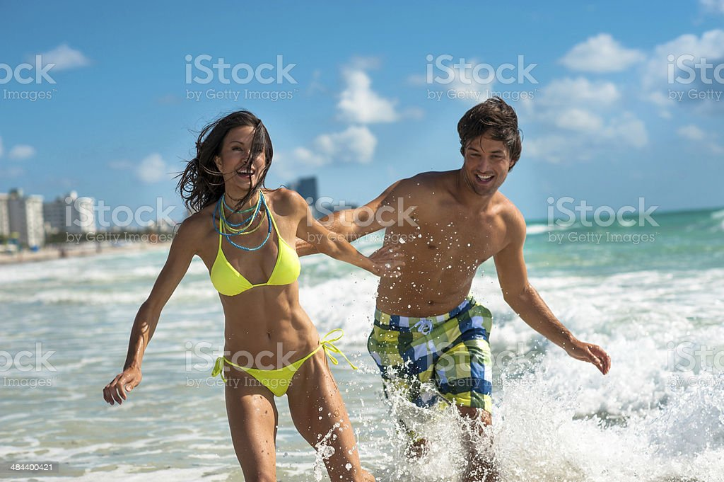 Young Couple Playing in Surf stock photo