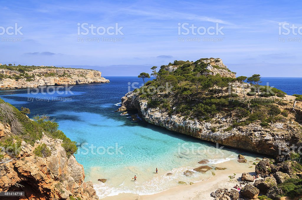 Young couple playing in water at beautiful beach stock photo