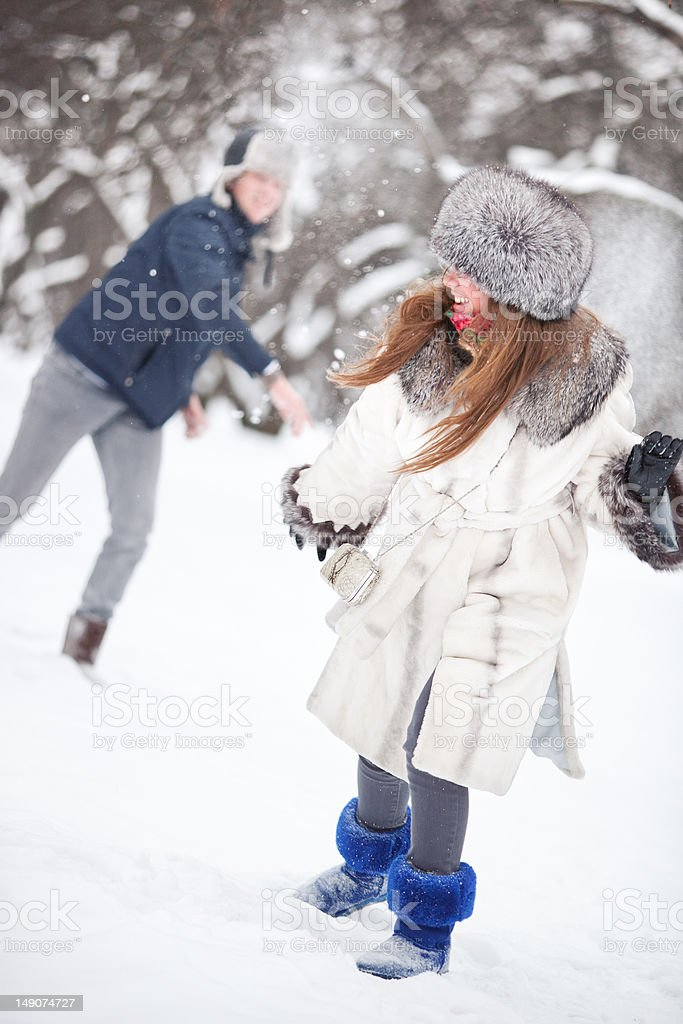 Young couple playing outdoors royalty-free stock photo