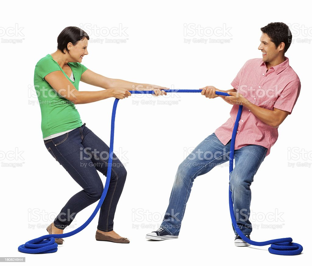 Young Couple Playing Tug-of-war - Isolated royalty-free stock photo