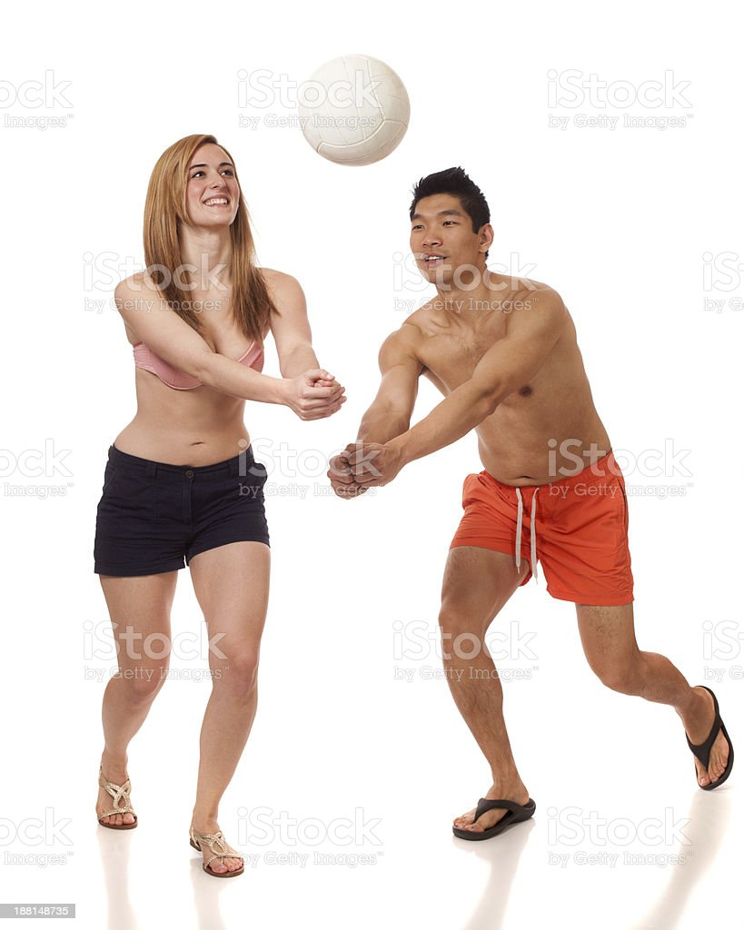 Young Couple Playing Volleyball royalty-free stock photo