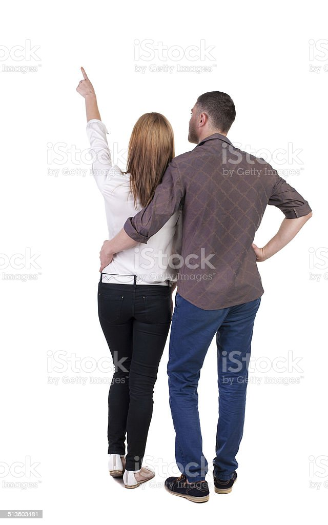young couple pointing. stock photo