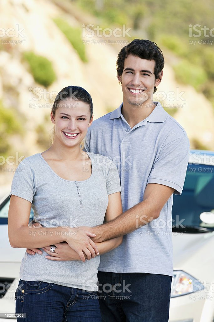 Young Couple Posing by Car royalty-free stock photo
