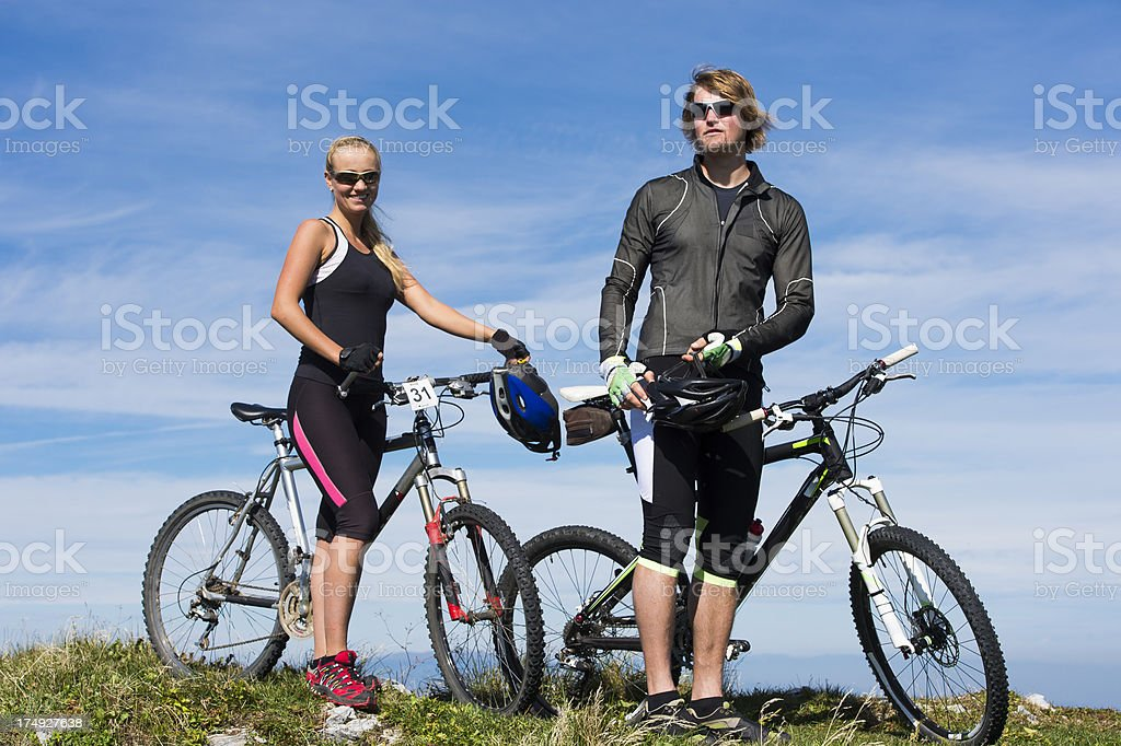 Young couple posing on the mountain peak royalty-free stock photo