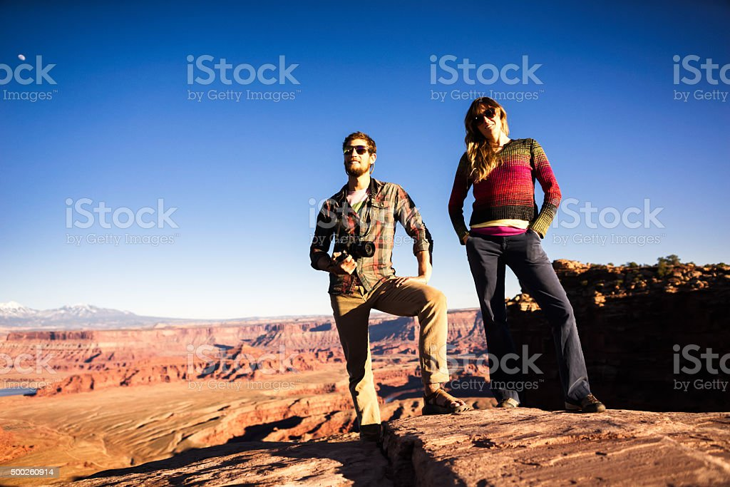 Young Couple Posing with Camera on Hike stock photo
