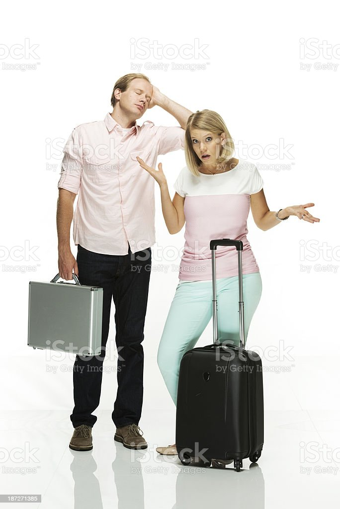 Young couple posing with suitcase royalty-free stock photo