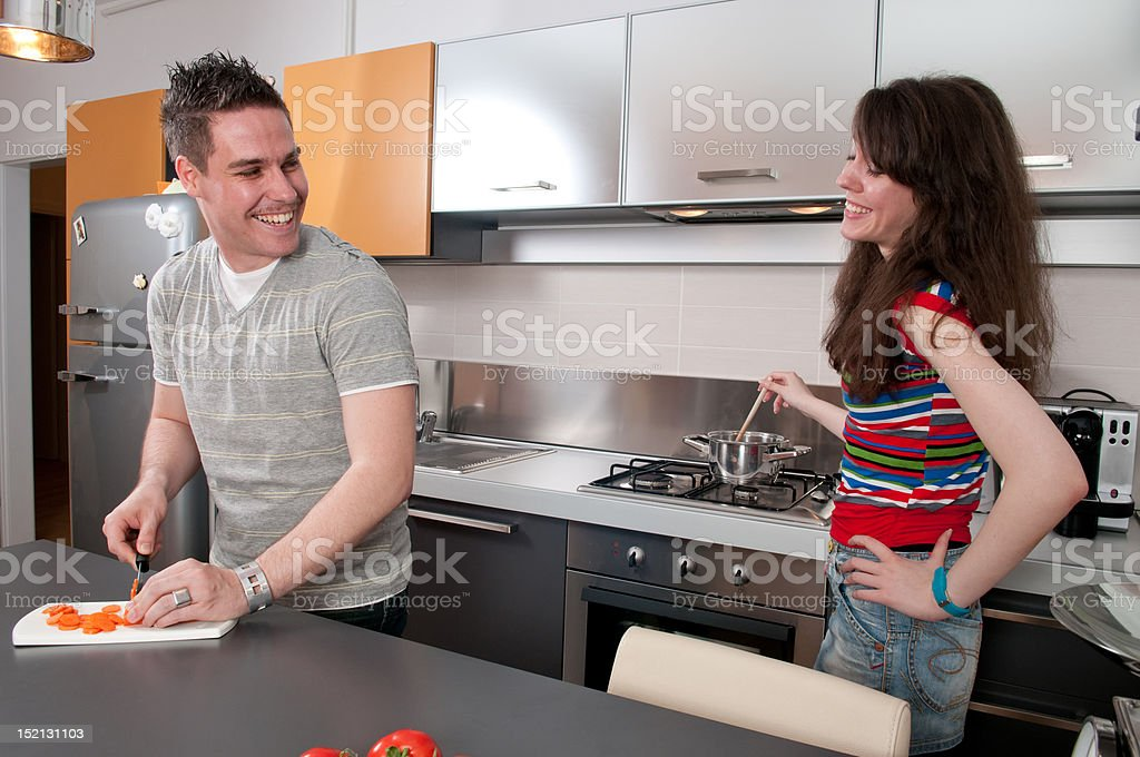Young couple preparing food royalty-free stock photo