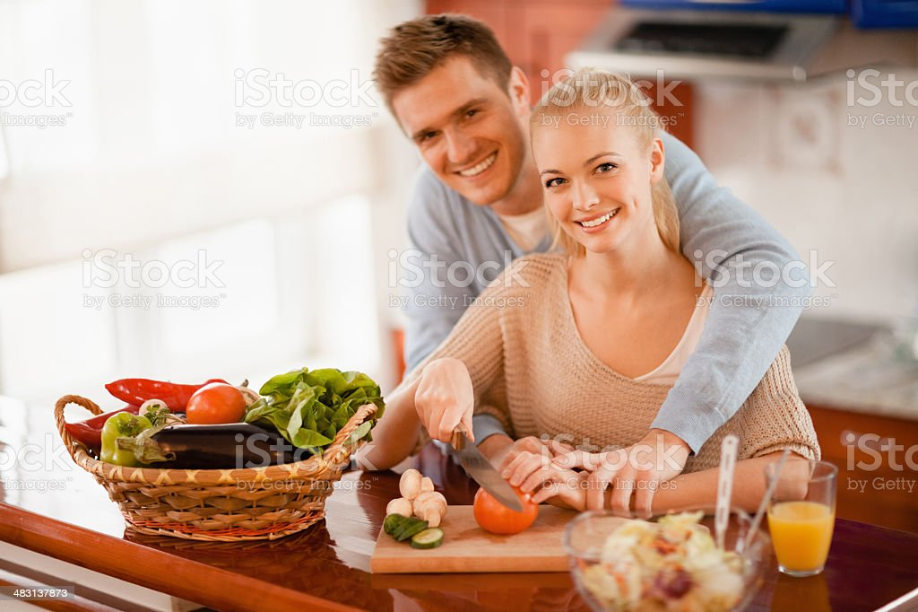 Young couple preparing food together royalty-free stock photo