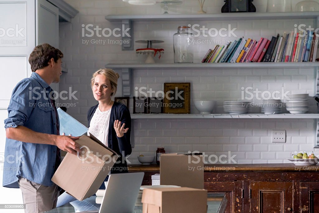 Young couple preparing gifts for Christmas at home stock photo