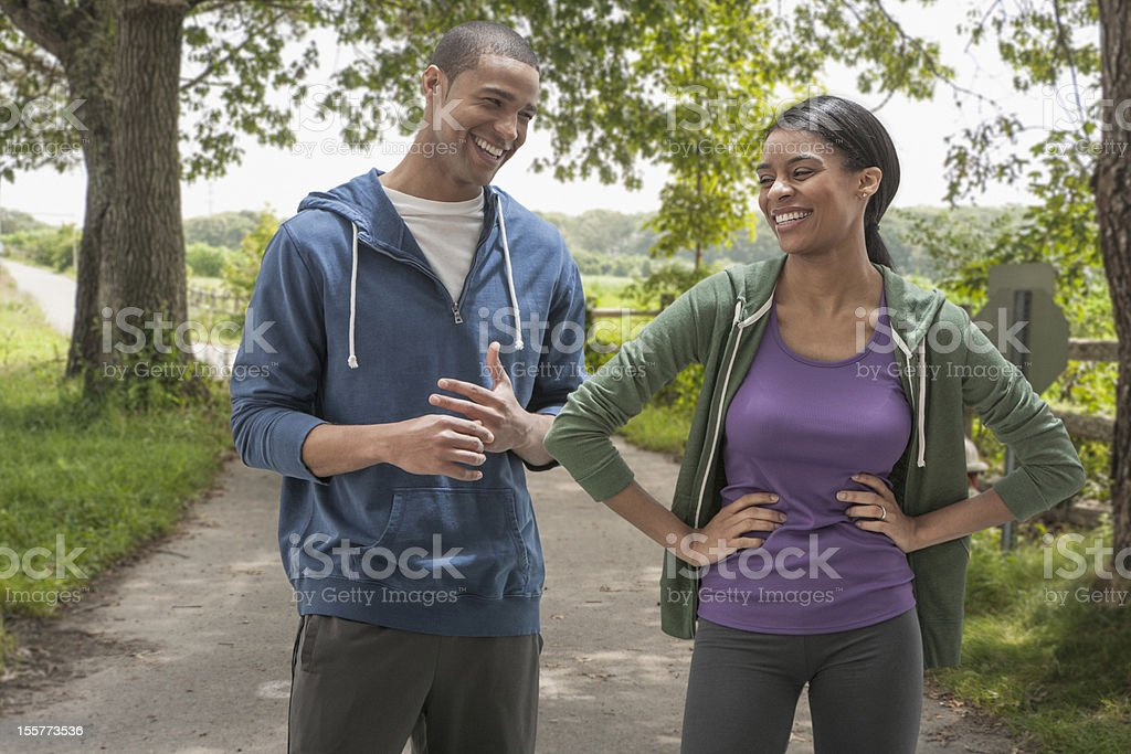 Young couple preparing to exercise outdoors royalty-free stock photo