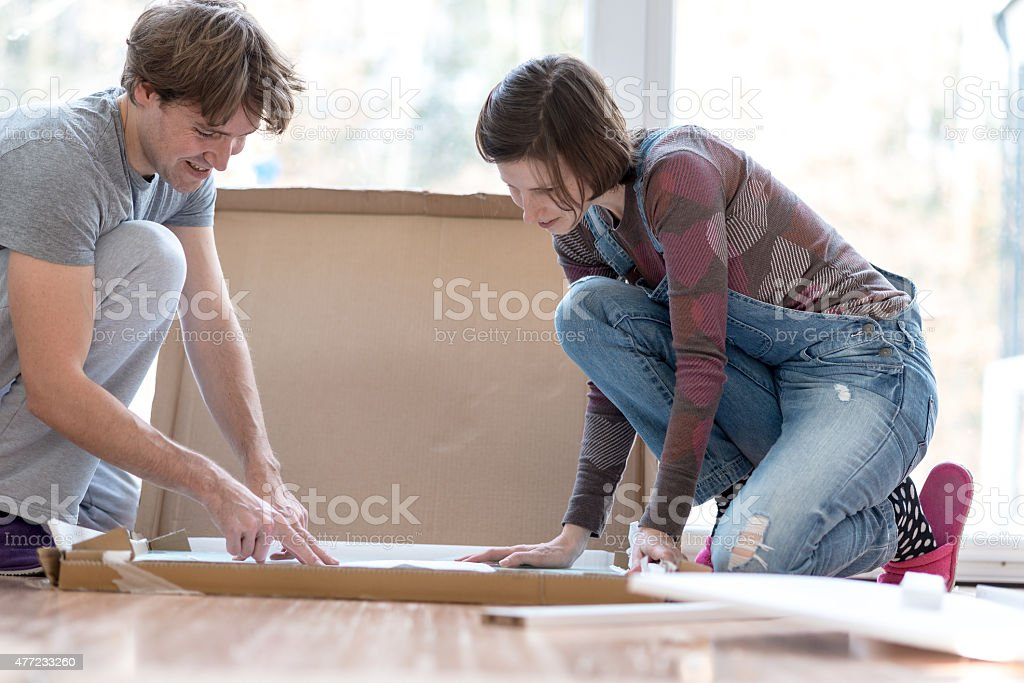 Young couple putting together new furinture stock photo