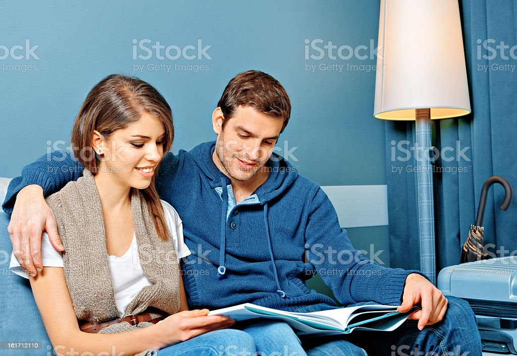 Young couple reading in a hotel room royalty-free stock photo